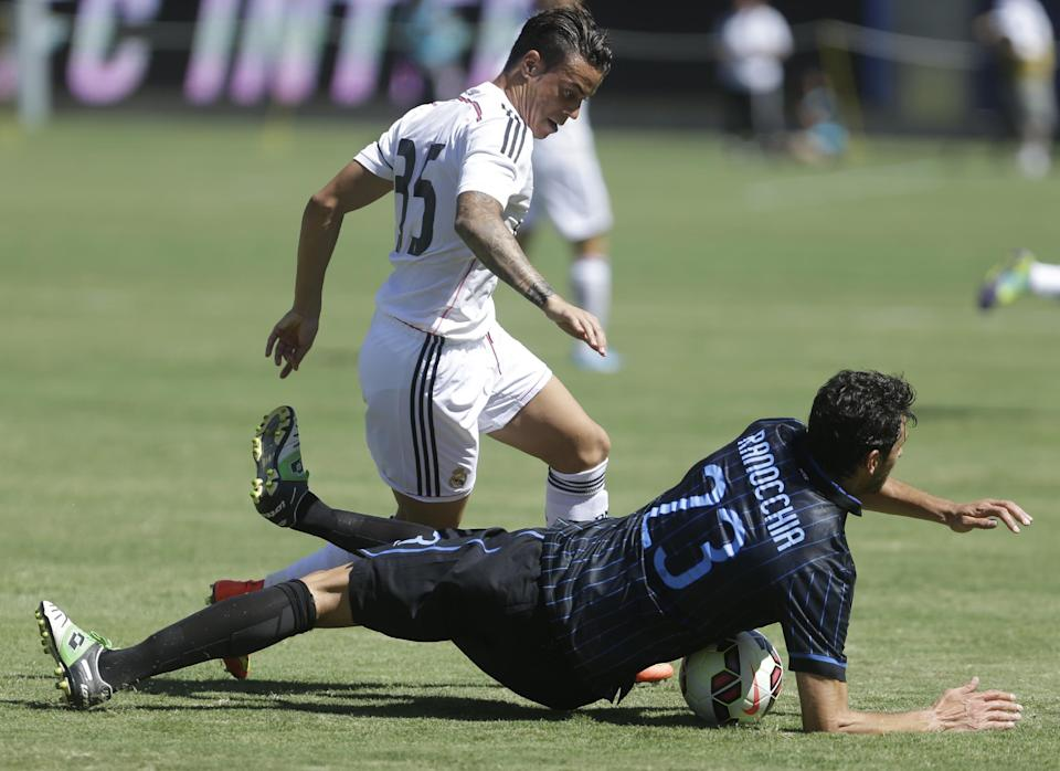 Real Madrid's Raul De Tomas (35) and Inter Milan's Andrea Ranocchia (23) fight for the ball during the first half of a soccer game in the first round of the Guinness International Champions Cup, Saturday, July 26, 2014, in Berkeley, Calif. (AP Photo/Ben Margot)