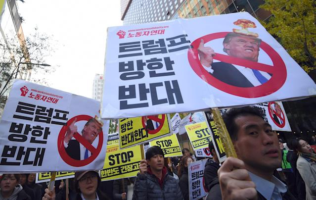 <p>South Korean protestors hold placards showing pictures of US President Donald Trump during an anti-Trump rally in Seoul on Nov. 4, 2017, ahead of Trump's visit to South Korea. (Photo: Jung Yeon-Je/AFP/Getty Images) </p>