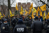 Protesters gather behind an NYPD barricade on Fifth Avenue outside the Consulate General of India, Tuesday, Jan. 26, 2021, in the Manhattan borough of New York. Tens of thousands of protesting farmers have marched, rode horses and drove long lines of tractors into India's capital, breaking through police barricades to storm the historic Red Fort. The farmers have been demanding the withdrawal of new laws that they say will favor large corporate farms and devastate the earnings of smaller scale farmers. Republic Day marks the anniversary of the adoption of India's constitution on Jan. 26, 1950. (AP Photo/John Minchillo)