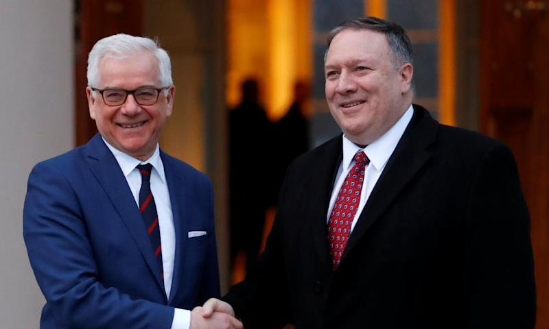 Poland's foreign minister, Jacek Czaputowicz, greets the US secretary of state, Mike Pompeo, in Warsaw