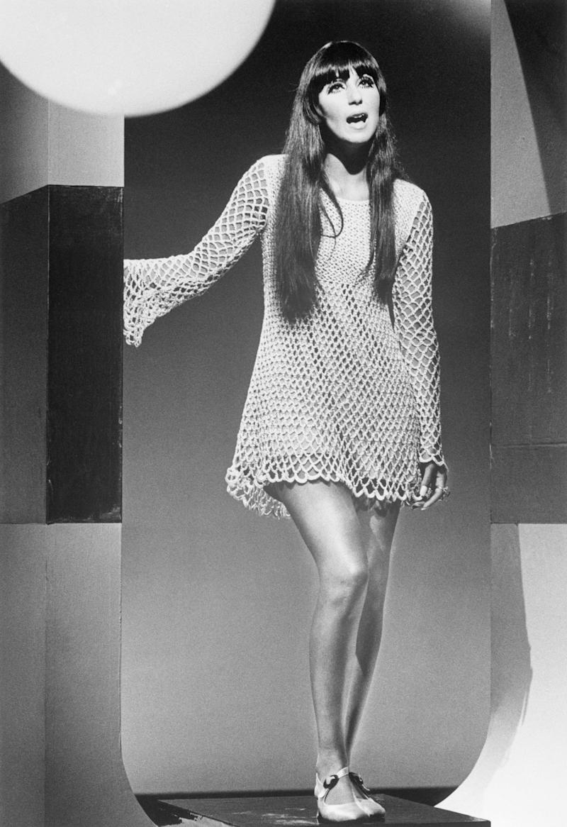 (Original Caption) 11/1967-Cher Bono, of Sonny & Cher, performing during a TV guest appearance. She is shown full length, wearing a crocheted mini-dress.