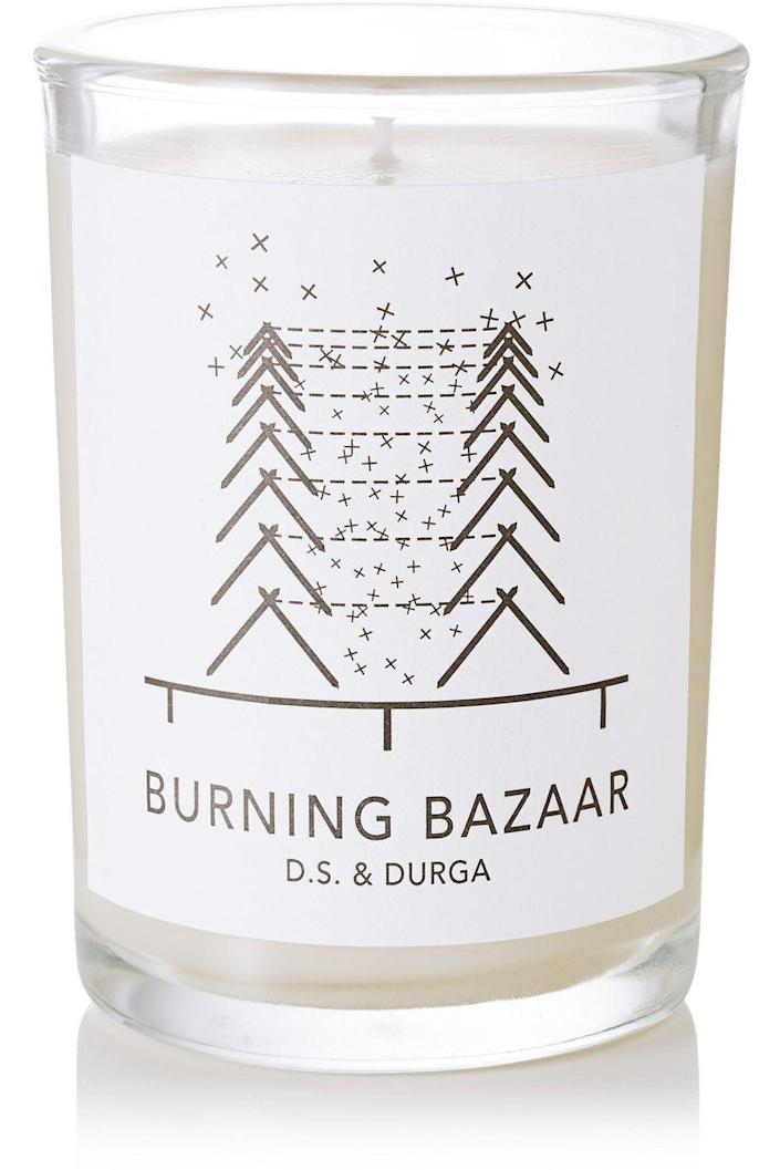 """<p>This limited edition candle will fill your home with house-warming notes of rosemary, cedar, clove, black pine and ginger.</p><br><br><strong>D.S. & Durga</strong> Burning Bazaar scented candle, 200g, $75, available at <a href=""""https://www.net-a-porter.com/us/en/product/704303/DS_and_Durga/burning-bazaar-scented-candle-200g"""" rel=""""nofollow noopener"""" target=""""_blank"""" data-ylk=""""slk:Net-A-Porter"""" class=""""link rapid-noclick-resp"""">Net-A-Porter</a>"""