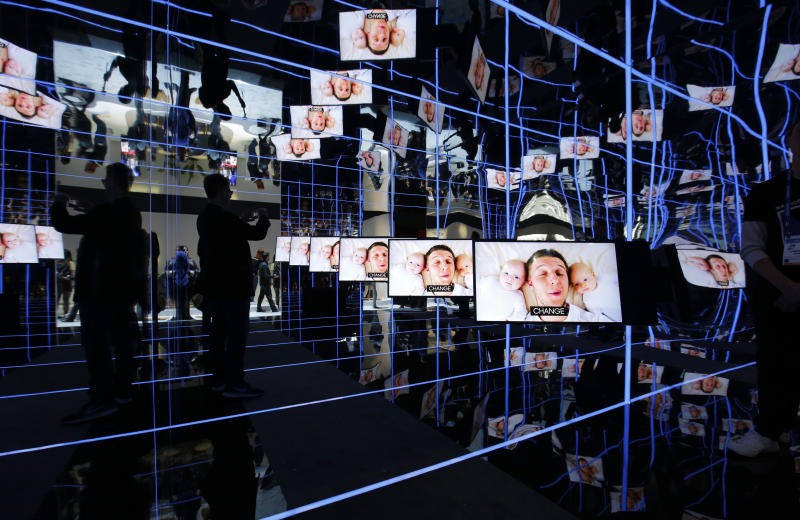 Samsung Sero TVs are on display at the Samsung booth during the CES tech show, Tuesday, Jan. 7, 2020, in Las Vegas. The TVs can rotate to play vertically or horizontally. (AP Photo/John Locher)
