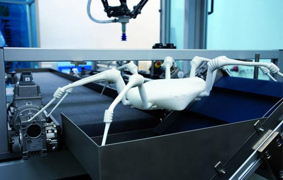 The robot spider's legs use elastic bellows drives as joints.