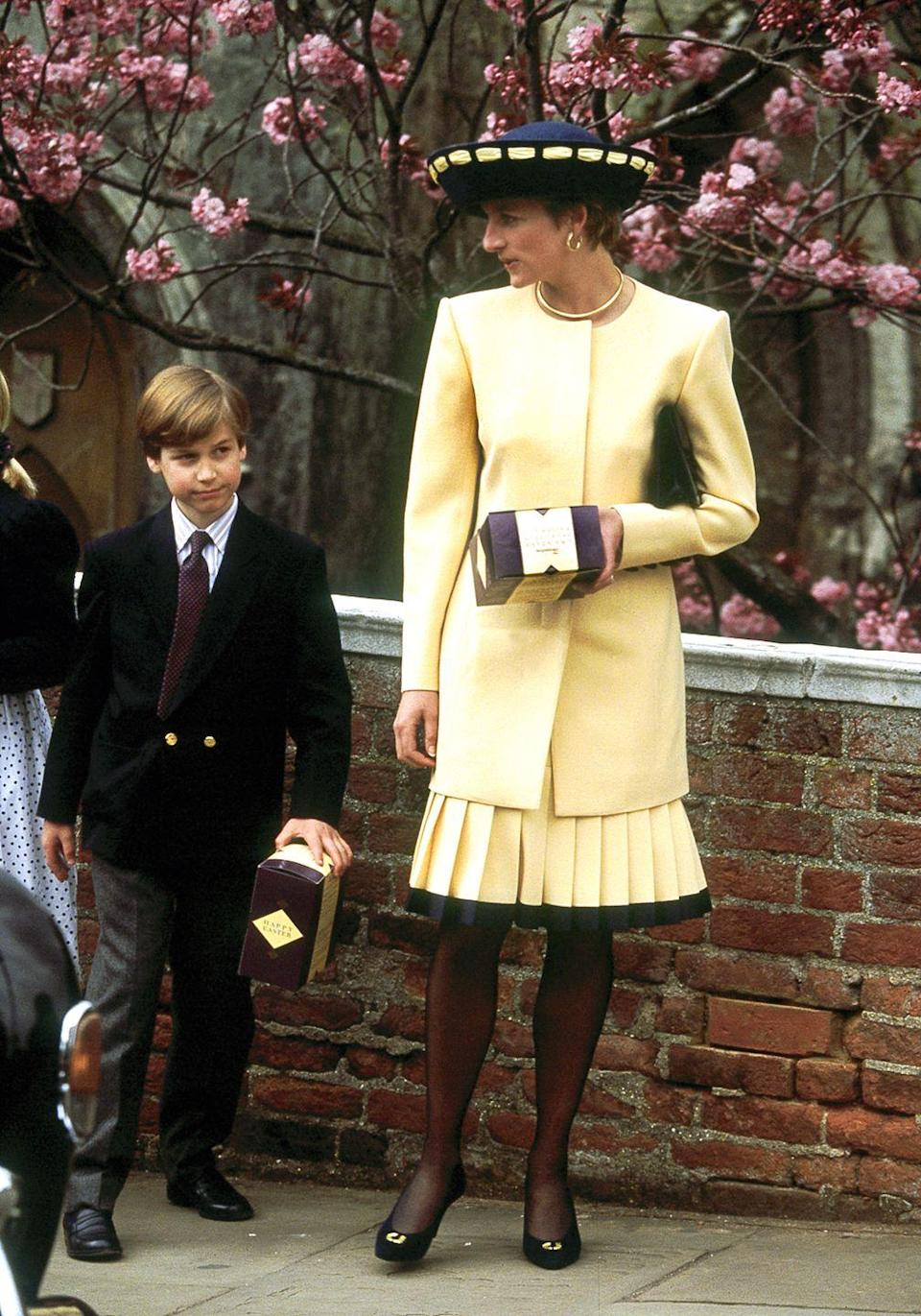 <p>In a yellow coat and pleated skirt with Prince William while leaving Windsor Chapel's Easter service. </p>
