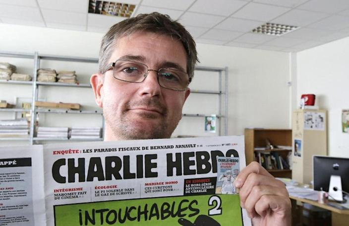 """The editor of the French satirical magazine killed in a terrorist attack in Paris on Wednesday had been on an al-Qaida """"hit list"""" for nearly two years, Yahoo News has learned. """"WANTED Dead or Alive for Crimes against Islam,"""" stated the March 2013 issue of Inspire, a Web magazine published by al-Qaida's Yemeni affiliate, above a photo of nine targets considered to be anti-Islam, including Stéphane Charbonnier, the editor of Charlie Hebdo, who was killed along with 11 others in today's attack. (The copy of Inspire can be read here — and the display showing Charbonnier as a target is on page 15.) Read more <strong>here</strong>."""