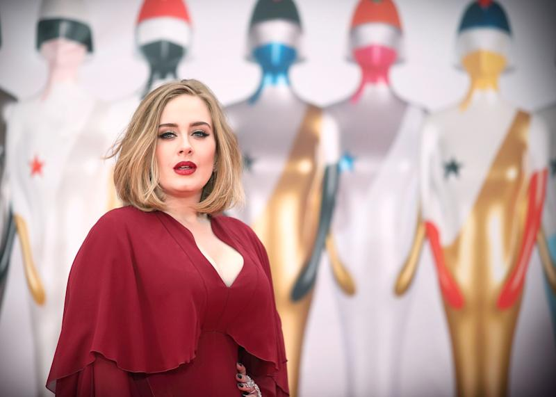 Adele in a red dress
