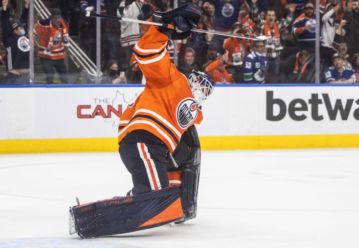 Edmonton Oilers goalie Mike Smith celebrates the team's shootout win over the Vancouver Canucks in an NHL hockey game Wednesday, Oct. 13, 2021, in Edmonton, Alberta. (Jason Franson/The Canadian Press via AP)