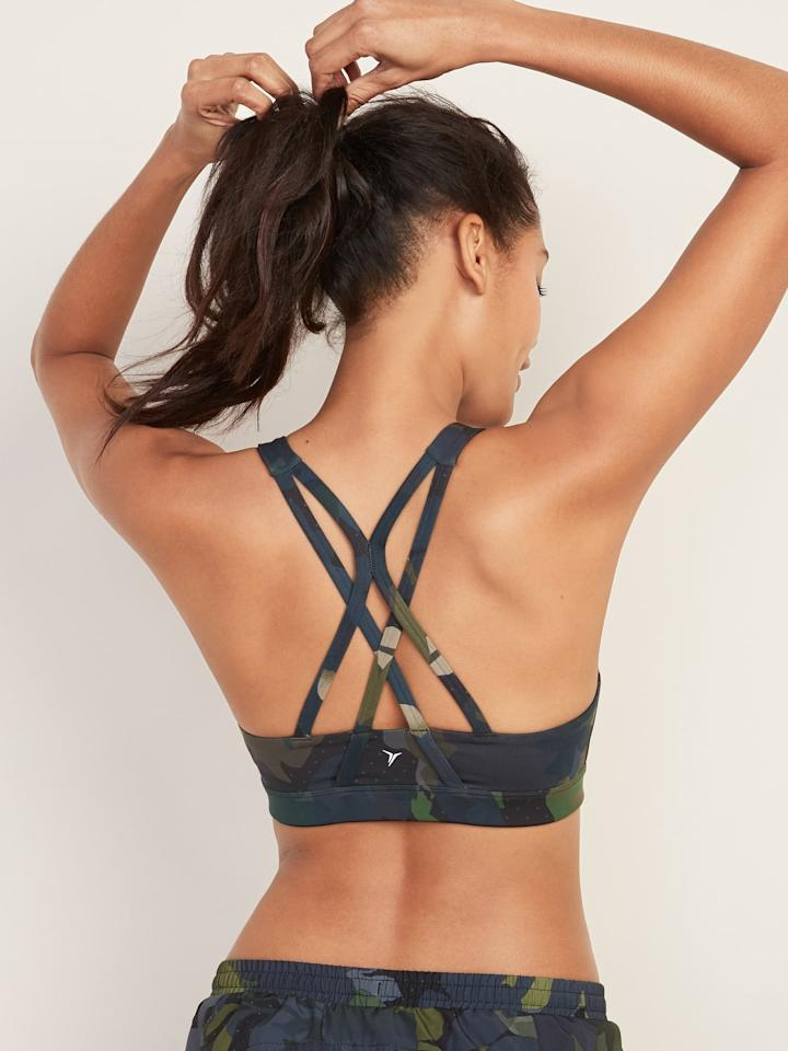 """<p>This <a href=""""https://www.popsugar.com/buy/Old-Navy-Medium-Support-Strappy-Sports-Bra-554981?p_name=Old%20Navy%20Medium-Support%20Strappy%20Sports%20Bra&retailer=oldnavy.gap.com&pid=554981&price=23&evar1=fit%3Aus&evar9=47291114&evar98=https%3A%2F%2Fwww.popsugar.com%2Fphoto-gallery%2F47291114%2Fimage%2F47291117%2FOld-Navy-Medium-Support-Strappy-Sports-Bra&list1=shopping%2Cworkout%20clothes%2Cproducts%20under%20%2425%2Cathleisure%2Caffordable%20shopping&prop13=api&pdata=1"""" rel=""""nofollow"""" data-shoppable-link=""""1"""" target=""""_blank"""" class=""""ga-track"""" data-ga-category=""""Related"""" data-ga-label=""""https://oldnavy.gap.com/browse/product.do?pid=220579462&amp;cid=1119388&amp;pcid=5508&amp;vid=1&amp;grid=pds_0_757_1#pdp-page-content"""" data-ga-action=""""In-Line Links"""">Old Navy Medium-Support Strappy Sports Bra</a> ($23) is a good option for so many different kinds of workouts.</p>"""
