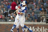 Atlanta Braves' Stephen Vogt hits a single during the second inning of a baseball game against the Milwaukee Brewers, Saturday, July 31, 2021, in Atlanta. (AP Photo/Hakim Wright Sr.)