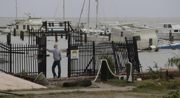 Myrle Tucker surveys the marina where is was rescued over night after his boat was damaged and sunk after it was hit by Hurricane Hanna, Sunday, July 26, 2020, in Corpus Christi,Texas. Tucker's boat and about 30 others were lost or damaged in the storm. (AP Photo/Eric Gay)