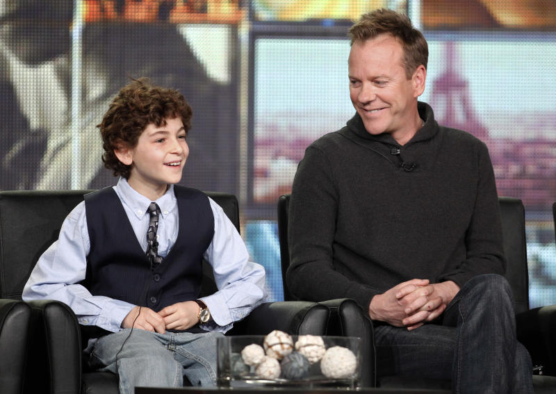 "Executive producer and cast member Kiefer Sutherland, right, and co-star David Mazouz smile during the panel discussion for the Fox television show ""Touch"" at the Fox Broadcasting Company Television Critics Association Winter Press Tour in Pasadena, Calif., on Sunday, Jan. 8, 2012. (AP Photo/Danny Moloshok)"