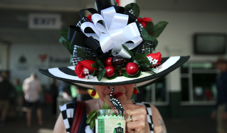 A woman enjoys a mint julep before the 142nd running of the Kentucky Derby at Churchill Downs in 2016. (Photo: Kramer Caswell/Louisville Courier-Journal via USA TODAY)