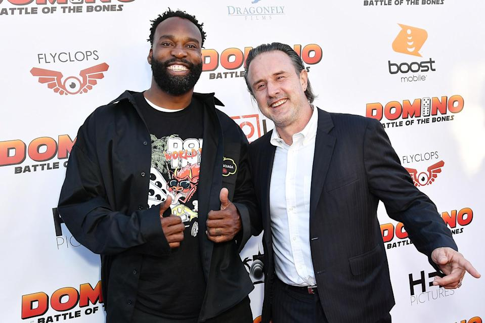 <p>Baron Davis and David Arquette are all smiles at the <em>Domino: Battle of the Bones</em> premiere in L.A. on June 9.</p>