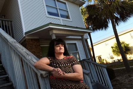 Cathy Sellars at her home in Fort Walton Beach, Florida, U.S. December 21, 2017. Picture taken December 21, 2017. REUTERS/Michael Spooneybarger