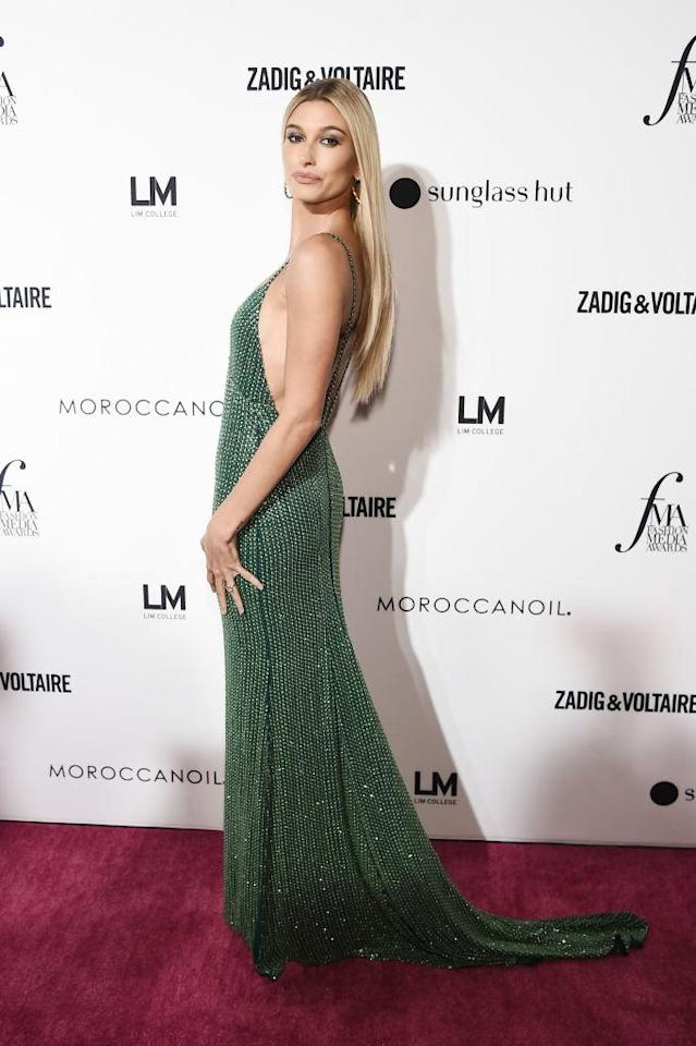 <p>Hailey Baldwin opted for a heavily embellished backless number for the Daily Front Row's Fashion Media Awards. <em>[Photo: Getty]</em> </p>