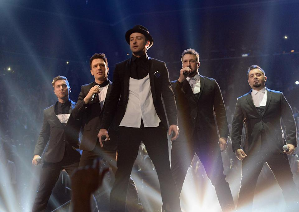 (L-R) Lance Bass, JC Chasez, Justin Timberlake, Joey Fatone and Chris Kirkpatrick of N Sync perform during the 2013 MTV Video Music Awards at the Barclays Center on August 25, 2013 in the Brooklyn borough of New York City.
