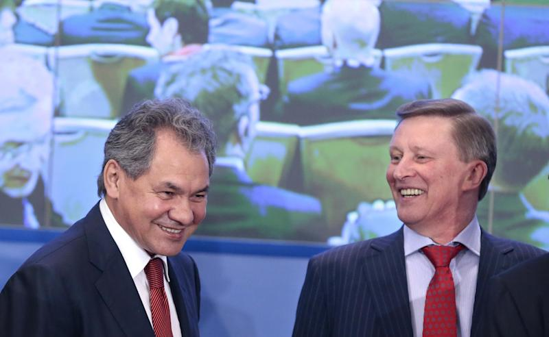 Attending a security conference, with from left, Russia's Defense Minister Sergei Shoigu, and the Kremlin's chief of staff Sergei Ivanov smile as they attend a security conference in Moscow, Russia, Thursday, May 23, 2013. Russian officials, who spoke at the conference organized by the Russian Defense Ministry, warned the West that the U.S.-led NATO's missile defense plans for Europe undermine Moscow's security.(AP Photo/Mikhail Metzel)
