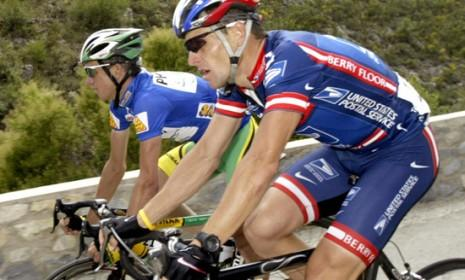 Lance Armstrong and teammate Tyler Hamilton compete in 2004: The legendary cyclist reportedly threatened Hamilton on learning that he planned to testify against Armstrong.