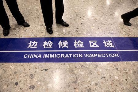 "A sign reading ""China Immigration Inspection"" is displayed on the ground in the Mainland Port Area at West Kowloon Station, which houses the terminal for the Guangzhou-Shenzhen-Hong Kong Express Rail Link (XRL), developed by MTR Corp., in Hong Kong, China, September 22, 2018. Giulia Marchi/Pool via REUTERS"