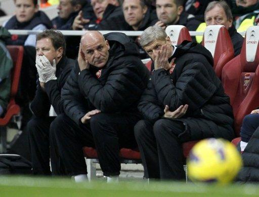 Arsene Wenger, far right, refused to write off Arsenal's chances in the Premier League