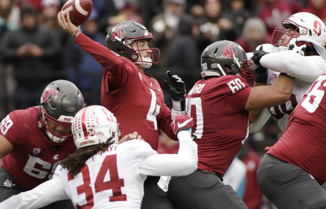 FILE--In this Nov. 4, 2017, file photo, Washington State quarterback Luke Falk (4) throws a pass during the second half of an NCAA college football game against Stanford in Pullman, Wash. An internal audit has found extensive mismanagement within the budget-challenged Washington State athletic department, including the possible inflation of home football attendance figures and the improper distribution of free tickets to football games. (AP Photo/Young Kwak, File)