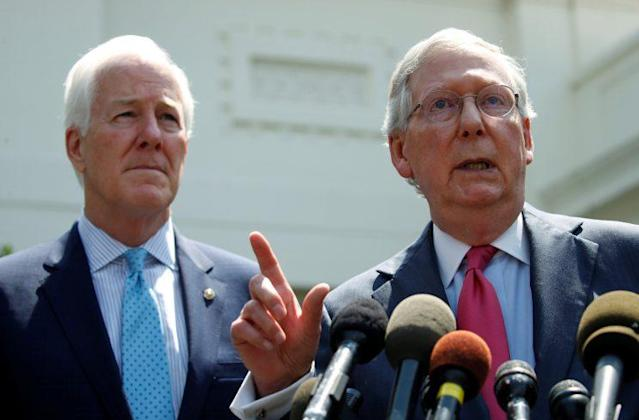 Senate Majority Whip John Cornyn and Senate Majority Leader Mitch McConnnell speak to reporters after meeting with the president to discuss health care on July 19. (Photo: Kevin Lamarque/Reuters)
