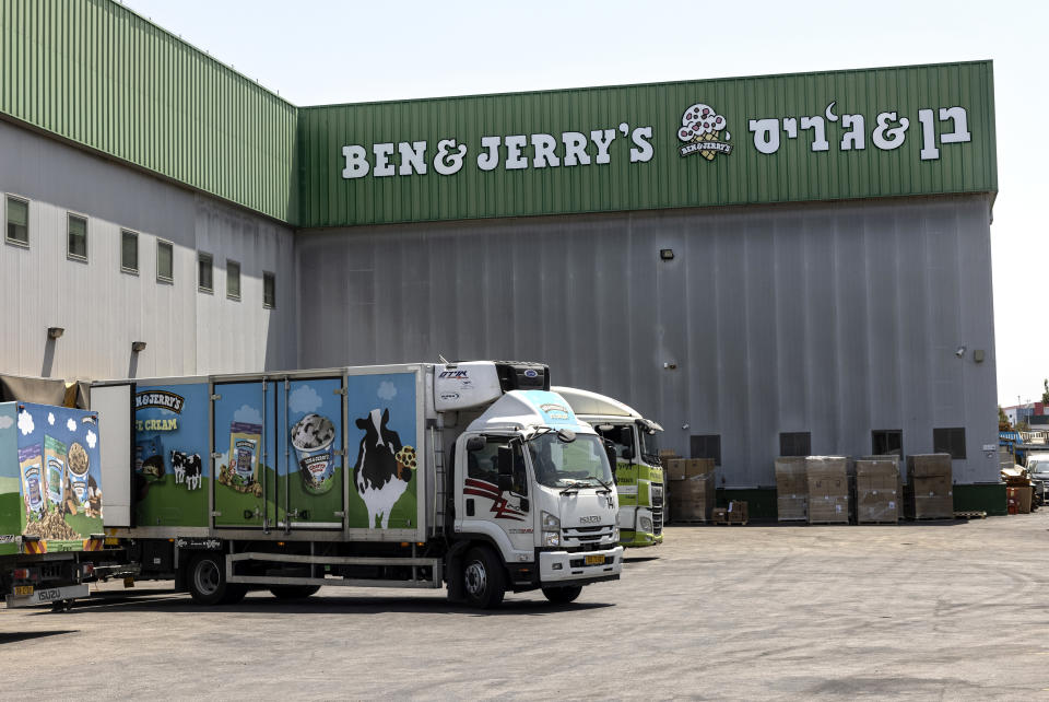 FILE - In this July 20, 2021, file photo, truck sare parked at the Ben & Jerry's ice-cream factory in the Be'er Tuvia Industrial area in Israel. The state of Arizona has sold off $93 million in Unilever bonds and plans to sell the remaining $50 million it has invested in the global consumer products company because its subsidiary Ben & Jerry's decided to stop selling its ice cream in Israeli-occupied territories in the latest in a series of actions by states with anti-Israel boycott laws. (AP Photo/Tsafrir Abayov, File)