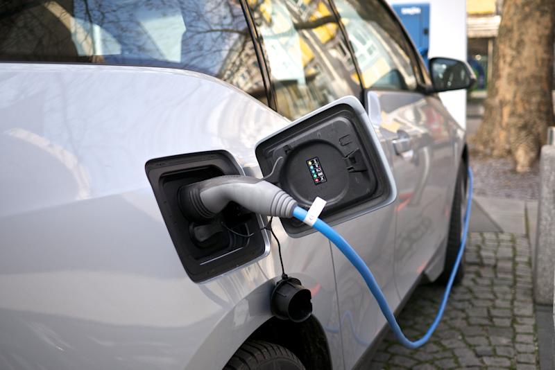 An electric car charging: Creative Commons
