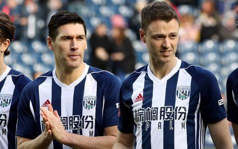 """Disgraced West Bromwich Albion captain Jonny Evans will be given every chance to redeem himself after head coach Alan Pardew stripped him of the armband for Saturday's FA Cup sixth-round clash against Southampton. Evans, one of the quartet dubbed The Cab Four after allegedly stealing a taxi at the end of an all-night bar crawl on a team trip to Barcelona last week, could yet face criminal charges along with Gareth Barry, Jake Livermore and Boaz Myhill following the incident, which is said to have taken place at around 5.30am on Thursday outside a 24-hour McDonald's takeaway in the Catalan capital. The four will be subject to the club's own disciplinary procedures regardless of the outcome of an ongoing Spanish police investigation and can expect hefty club fines, but Albion are particularly anxious to avoid any fractured relationships, especially with Evans. In addition to needing his leadership qualities if they are to have any chance of avoiding relegation from the Premier League, the club have an interest in maintaining his current high transfer value. He is believed to have a clause in his contract that will trigger a cut-price exit if Albion go down but should they survive they will be desperately keen to realise at least a sizeable percentage of their £25 million valuation, having rejected bids from Manchester City, Leicester City and Arsenal in the last two transfer windows. Gareth Barry, left, was also among the four who apologised on Friday Credit: PA With his contract due to run out next year, the next window is likely to be the last chance to cash in. Pardew hinted strongly in the wake of Saturday's defeat that his decision to hand the captaincy to veteran defender Gareth McAuley may have been only a slap on the wrists for Evans. """"Obviously I was furious with what happened but at the same time I've got to give the players the chance to remedy the situation,"""" he said, before adding that he had been impressed in particular with the way Evans had responded. """