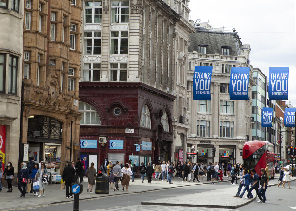 """Crowds gather in Oxford Street with """"Thank you"""" signs above them as people in London, UK on July 11, 2020  prepare for the possibility of Face coverings becoming mandatory in shops and other public places across the UK.  (Photo by Jacques Feeney/MI News/NurPhoto via Getty Images)"""