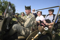 World War II history enthusiasts parade in WWII vehicles in Colleville-Montgomery,, Normandy, Saturday June, 5 2021 on the eve of 77th anniversary of the assault that helped bring an end to World War II. While France is planning to open up to vaccinated visitors starting next week, that comes too late for the D-Day anniversary. So for the second year in a row, most public commemoration events have been cancelled. A few solemn ceremonies have been maintained, in the presence of dignitaries and a few guests only. (AP Photo/David Vincent)