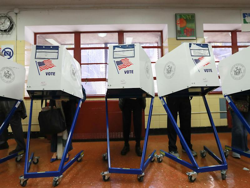 Voters casting their ballots in the US election last November. Despite winning the Electoral College vote, President Trump still alleges voter fraud took place: Michael Reaves/Getty Images