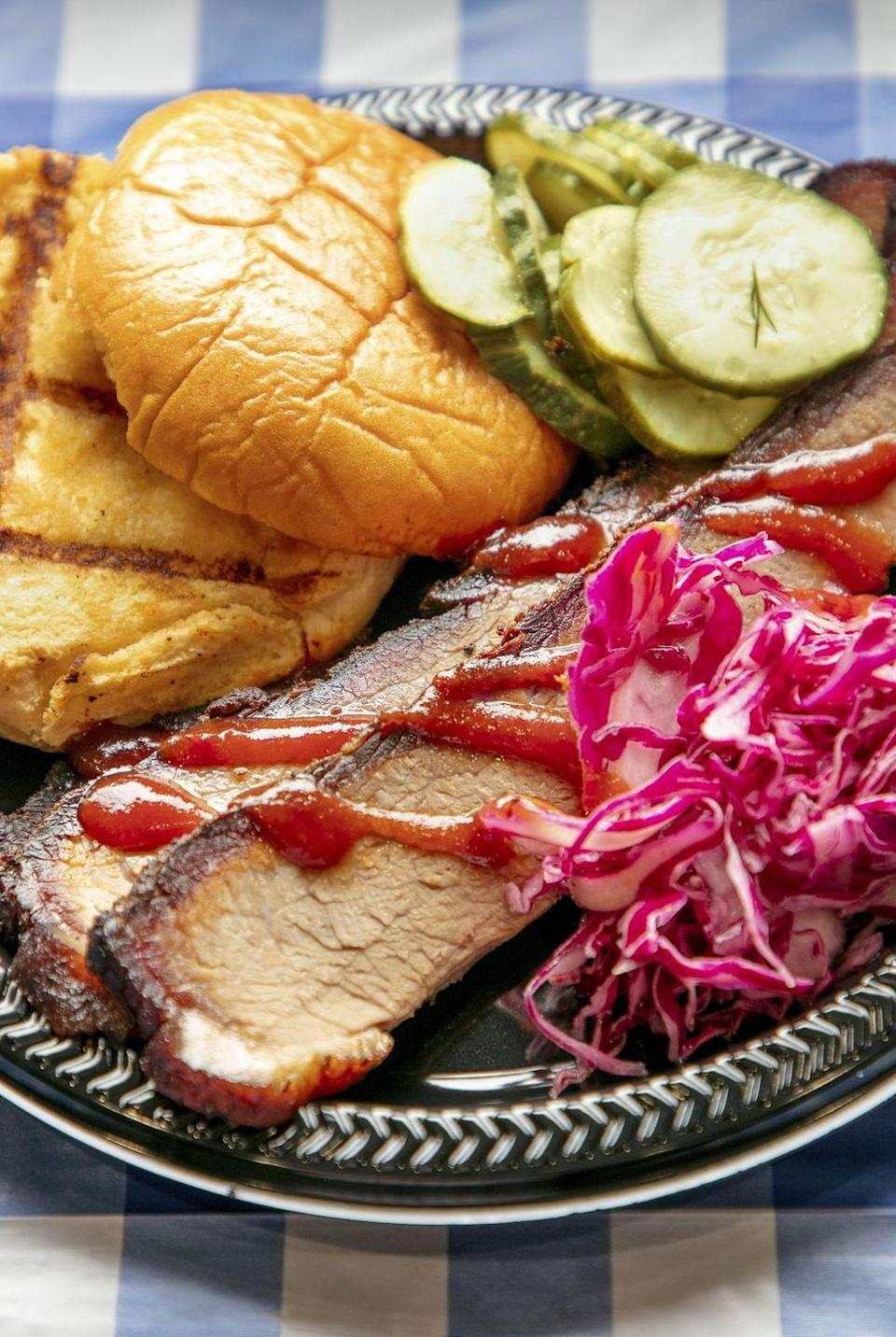 """<p>Make this tender brisket ahead, then finish it off on the grill just before serving. It's delicious on its own or pile it onto a toasted bun with some of our favorites: BBQ sauce, coleslaw, and pickles. </p><p><a href=""""https://www.thepioneerwoman.com/food-cooking/recipes/a35993018/spicy-bbq-brisket-recipe/"""" rel=""""nofollow noopener"""" target=""""_blank"""" data-ylk=""""slk:Get Ree's recipe."""" class=""""link rapid-noclick-resp""""><strong>Get Ree's recipe.</strong></a></p><p><a class=""""link rapid-noclick-resp"""" href=""""https://go.redirectingat.com?id=74968X1596630&url=https%3A%2F%2Fwww.walmart.com%2Fsearch%2F%3Fquery%3Dpioneer%2Bwoman%2Bknives&sref=https%3A%2F%2Fwww.thepioneerwoman.com%2Ffood-cooking%2Fmeals-menus%2Fg36109352%2Ffathers-day-dinner-recipes%2F"""" rel=""""nofollow noopener"""" target=""""_blank"""" data-ylk=""""slk:SHOP KNIVES"""">SHOP KNIVES</a></p>"""