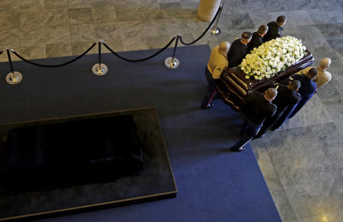 The casket is moved