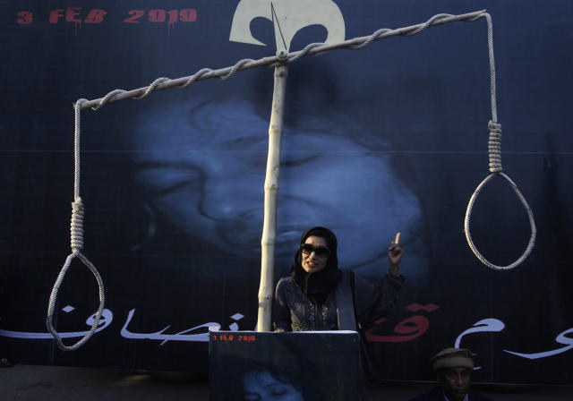 <p>Dr. Fauzia Siddiqui, the sister of U.S.-trained Pakistani scientist Aafia Siddiqui, who was convicted in Sept. 2010 of trying to kill U.S. agents and military officers in Afghanistan, addresses protesters to condemn her sister's continued detention, Karachi, Pakistan, Feb. 3, 2012. (AP Photo/Shakil Adil) </p>