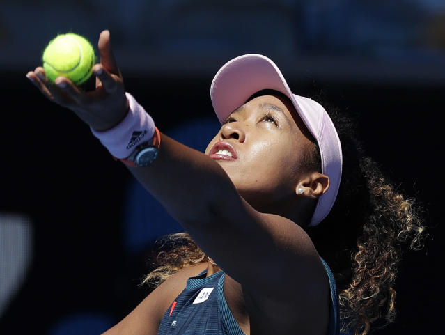 Japan's Naomi Osaka serves to Taiwan's Hsieh Su-Wei during their third round match at the Australian Open tennis championships in Melbourne, Australia, Saturday, Jan. 19, 2019. (AP Photo/Kin Cheung)