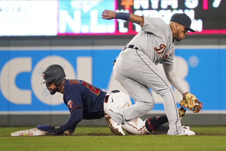 Minnesota Twins' Byron Buxton, left, steals second base on Detroit Tigers second baseman Isaac Paredes in the third inning of a baseball game, Tuesday, Sept. 28, 2021, in Minneapolis. (AP Photo/Jim Mone)