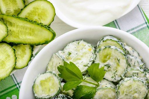 """<p>Thanks to the flavonoid antioxidant quercetin (which reduces swelling) and a high water content of 96%, cucumbers """"can definitely <a href=""""https://www.health.com/health/video/0,,20983852,00.html"""" target=""""_blank"""">help prevent bloating</a>,"""" says Gans. This crunchy veggie is also extremely versatile: eat it in a chopped salad, sprinkle on top of yogurt, or munch on cucumber slices with <a href=""""https://www.health.com/health/video/0,,20926304,00.html"""">homemade hummus</a>. </p> <p><strong>RELATED: <a href=""""https://www.health.com/nutrition/cucumber-diet"""">What Is the Cucumber Diet?</a></strong></p>"""