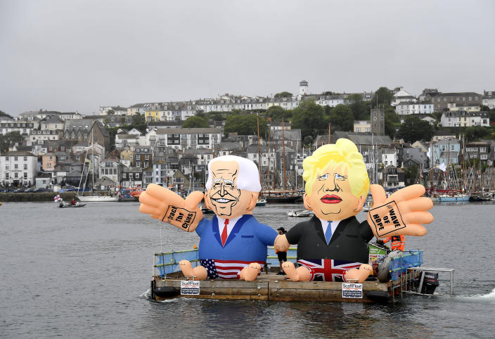 Two giant balloons depicting U.S. President Joe Biden, left, and British Prime Minister Boris Johnson float on a dock during a 'crack the crisis' action by NGO's in the harbour of Falmouth, Cornwall, England, during an action by NGO's on Friday, June 11, 2021. Leaders of the G7 begin their first of three days of meetings on Friday in Carbis Bay, in which they will discuss COVID-19, climate, foreign policy and the economy. (AP Photo/Alberto Pezzali)