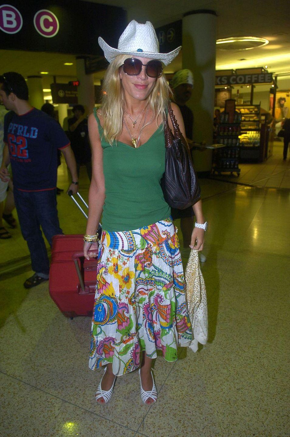 <p>Tori Spelling dresses the part for her South Beach vacation as she arrives at the airport in Miami in June 2005. </p>