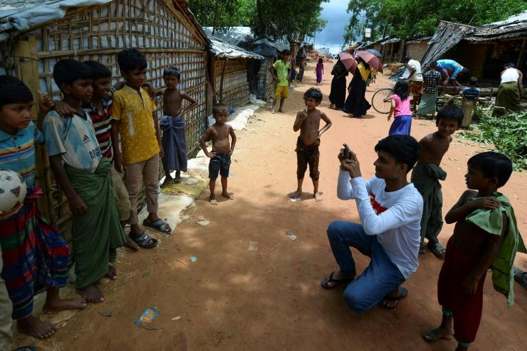 Mohammad Rafiq (2nd R, in white) is among some 30 Rohingya youths selected by the World Food Programme for its 'Storytellers' project