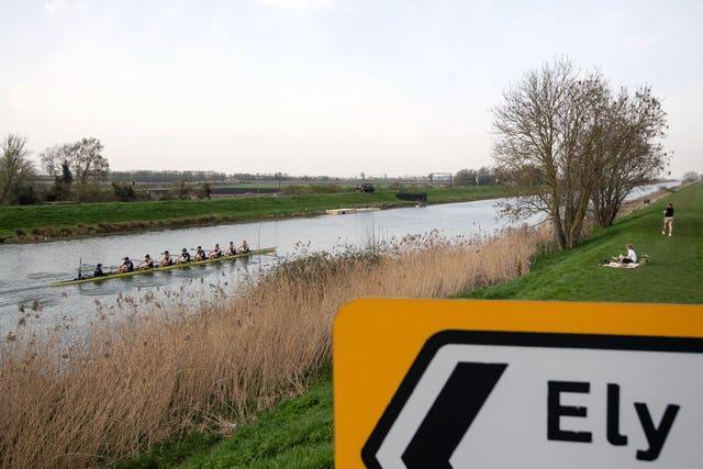 Oxford University Boat Club train on the River Great Ouse near Ely in Cambridgeshire