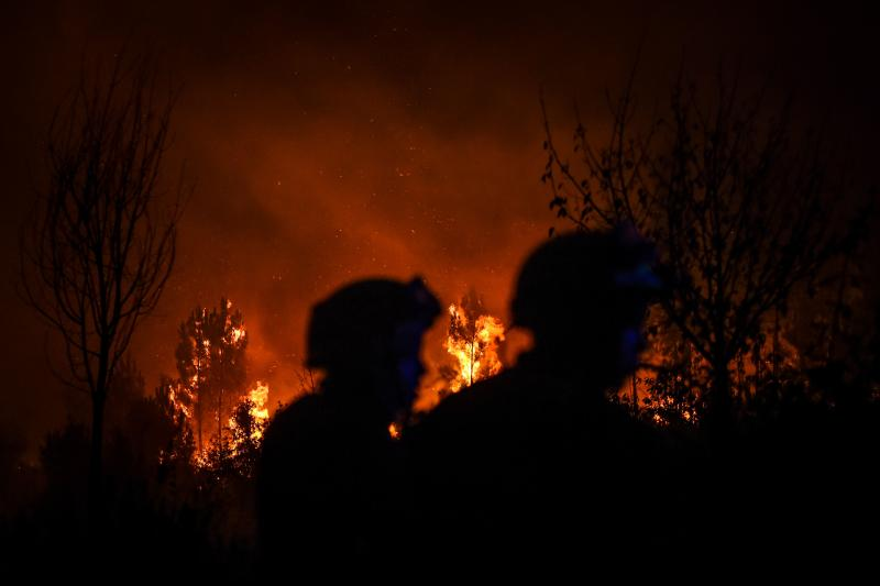Firefighters are at work to extinguish a wildfire in Cardigos village in Macao, central Portugal on July 21, 2019. (Photo: Patricia De Melo Moreira/AFP/Getty Images)