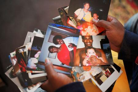 Quinta Sanders shows photos she saved of her son, Tory Sanders, at her home in Nashville, Tennessee, U.S. October 10, 2017. Picture taken October 10, 2017.  REUTERS/Harrison McClary