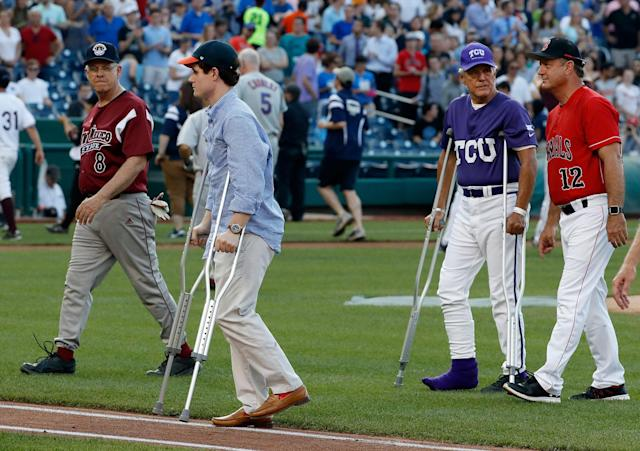 <p>Injured aide Zach Barth, left, and Rep. Roger Williams, R-Texas, also on crutches walk off the field before the Congressional baseball game, Thursday, June 15, 2017, in Washington. (Photo: Alex Brandon/AP) </p>