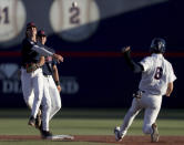 Mississippi second baseman Peyton Chatagnier throws after forcing out Arizona's Daniel Susac (6) to complete a double play in an NCAA college baseball tournament super regional game Friday, June 11, 2021, in Tucson, Ariz. (Kelly Presnell/Arizona Daily Star via AP)