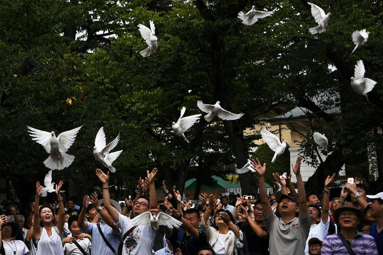 Doves are released as a symbol of peace at the Yasukuni shrine in Tokyo on the 74th anniversary of Japan's surrender in World War II (AFP Photo/CHARLY TRIBALLEAU)