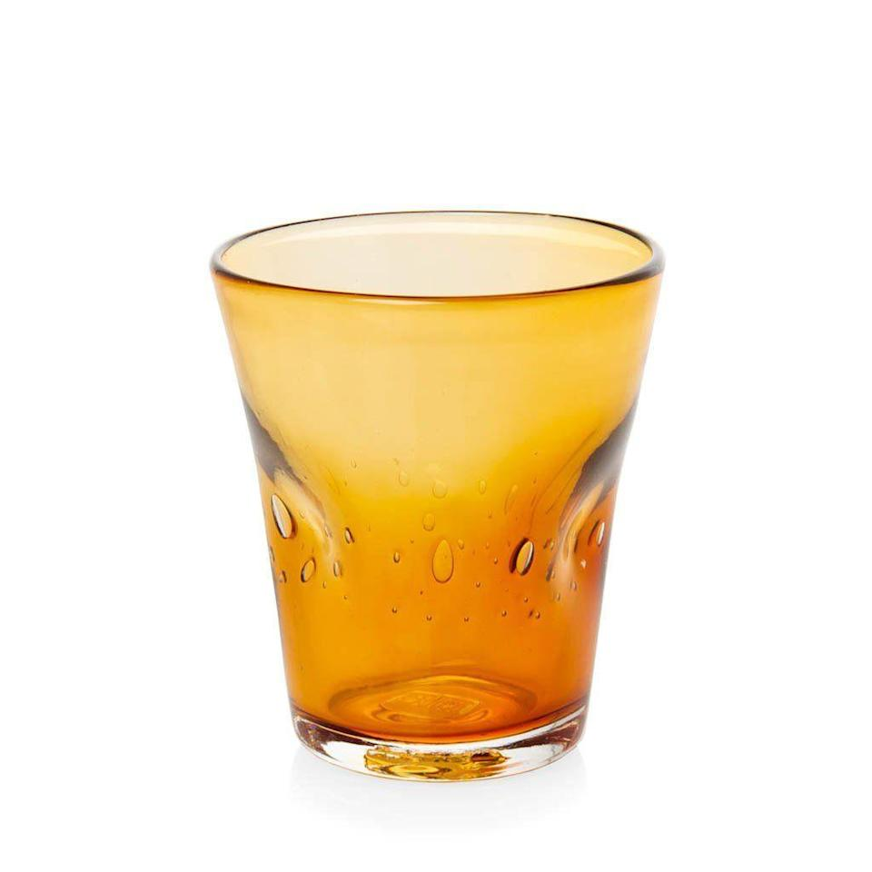 """<p><strong>Hudson Grace</strong></p><p><strong>$16.00</strong></p><p><a href=""""https://hudsongracesf.com/collections/new-arrivals/products/henri-glass-amber"""" rel=""""nofollow noopener"""" target=""""_blank"""" data-ylk=""""slk:Shop Now"""" class=""""link rapid-noclick-resp"""">Shop Now</a></p><p>Use these mouth-blown glasses for a pop of pumpkin, or mix and match them with other colors for a whole latte fun.</p>"""