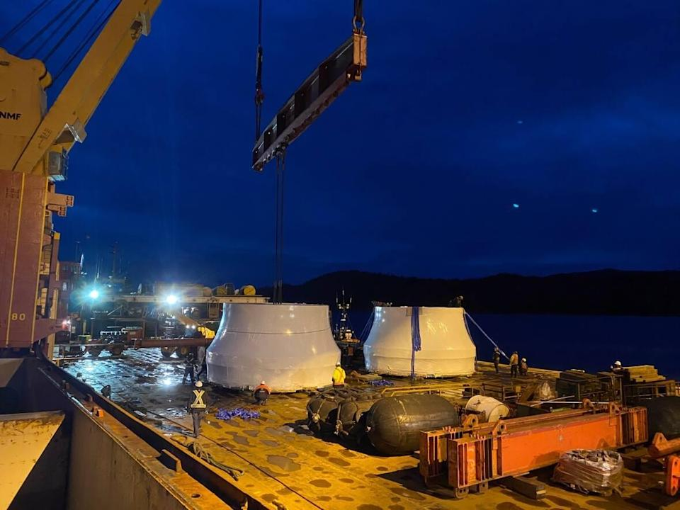 B.C. Hydro moves two giant turbine parts for the Site C dam. Built in Brazil and shipped to Prince Rupert, the turbine runners were trucked across northern B.C. to the $10 billion dam construction site.  (Submitted by B.C. Hydro - image credit)